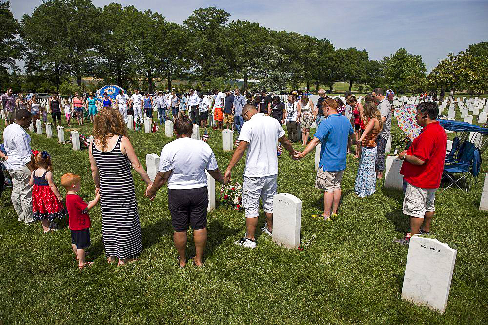 Gold Star family members in a circle holding hands